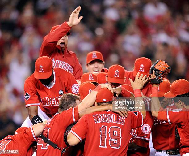 Pitcher Ervin Santana of the Los Angeles Angels of Anaheim is mobbed by his teammates after shutting out the Texas Rangers 110 and win the American...