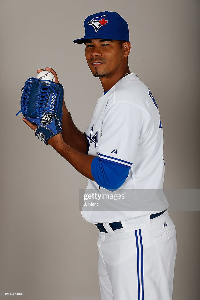 Pitcher Esmil Rogers #32 of the Toronto Blue Jays poses for a photo during photo day at Florida Auto Exchange Stadium on February 18, 2013 in Dunedin, Florida.
