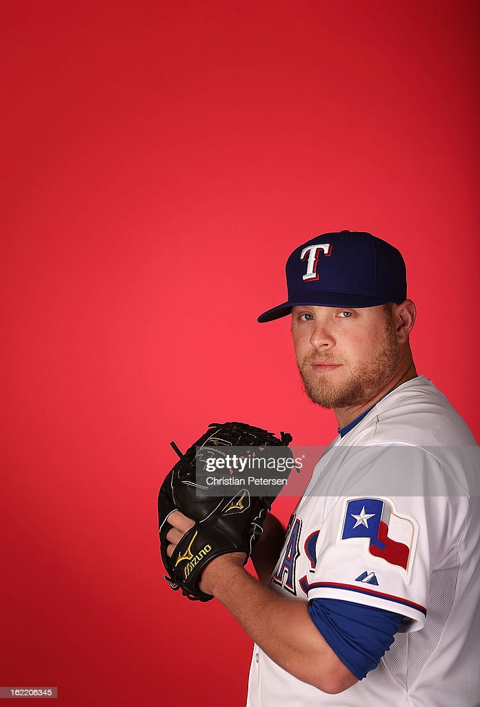 Pitcher Evan Meek #62 of the Texas Rangers poses for a portrait during spring training photo day at Surprise Stadium on February 20, 2013 in Surprise, Arizona.