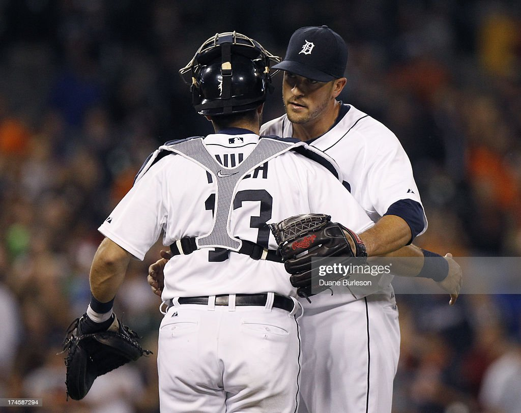Pitcher Evan Reed #57 of the Detroit Tigers hugs catcher <a gi-track='captionPersonalityLinkClicked' href=/galleries/search?phrase=Alex+Avila&family=editorial&specificpeople=5749211 ng-click='$event.stopPropagation()'>Alex Avila</a> #13 after a 10-0 win over the Philadelphia Philles at Comerica Park on July 27, 2013 in Detroit, Michigan.