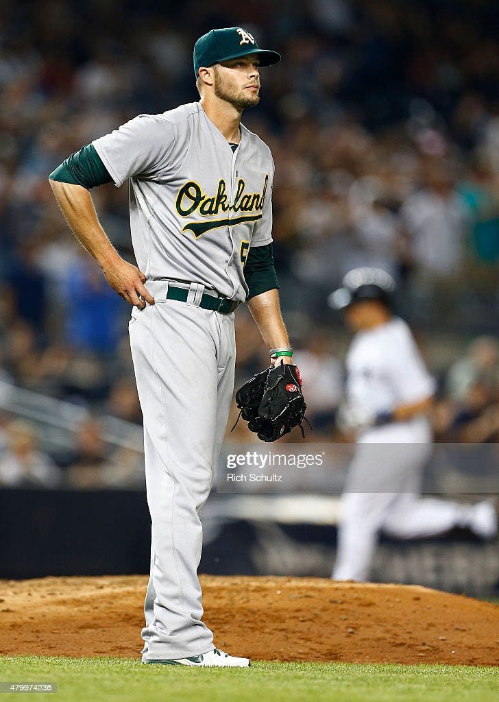 Pitcher Evan Scribner #58 of the Oakland Athletics looks to the outfield after giving up a home run to Mark Teixeira #25 of the New York Yankees who rounds third base during the sixth inning of a MLB baseball game at Yankee Stadium on July 8, 2015 in the Bronx borough of New York City.