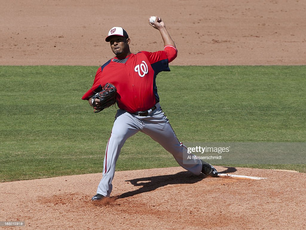 Pitcher Fernando Abad #58 of the Washington Nationals throws in relief against the Philadelphia Phillies March 6, 2013 at Bright House Field in Clearwater, Florida.