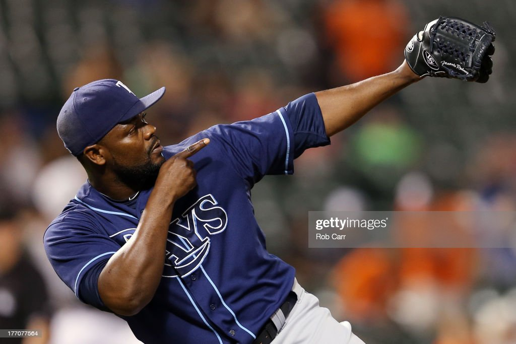 Pitcher <a gi-track='captionPersonalityLinkClicked' href=/galleries/search?phrase=Fernando+Rodney&family=editorial&specificpeople=547291 ng-click='$event.stopPropagation()'>Fernando Rodney</a> #56 of the Tampa Bay Rays celebrates after the Ray defeated the Baltimore Orioles 7-4 at Oriole Park at Camden Yards on August 20, 2013 in Baltimore, Maryland.