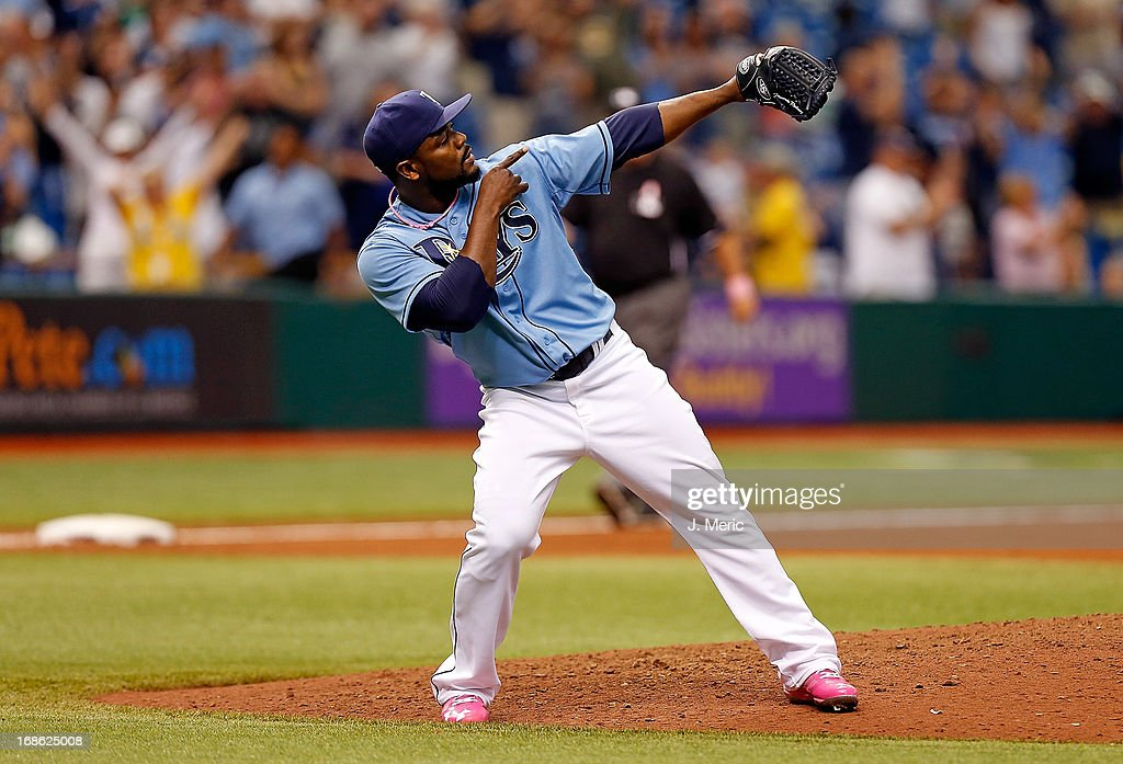 Pitcher <a gi-track='captionPersonalityLinkClicked' href=/galleries/search?phrase=Fernando+Rodney&family=editorial&specificpeople=547291 ng-click='$event.stopPropagation()'>Fernando Rodney</a> #56 of the Tampa Bay Rays celebrates his save over the San Diego Padres at Tropicana Field on May 12, 2013 in St. Petersburg, Florida.