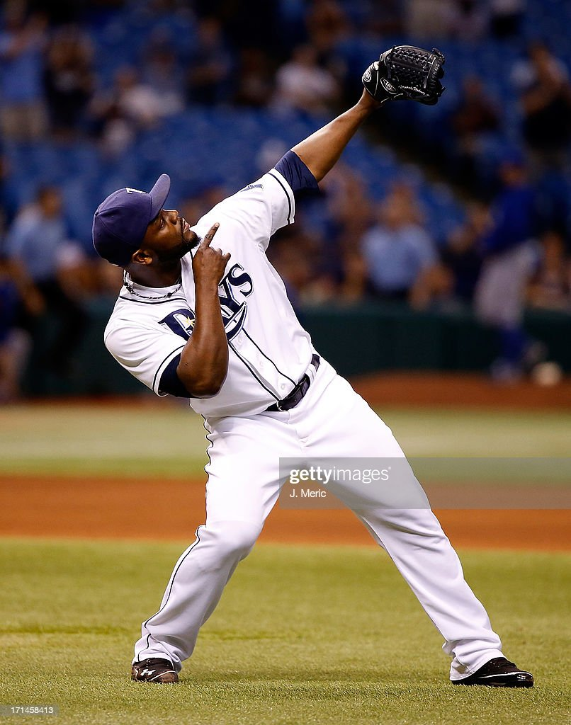 Pitcher <a gi-track='captionPersonalityLinkClicked' href=/galleries/search?phrase=Fernando+Rodney&family=editorial&specificpeople=547291 ng-click='$event.stopPropagation()'>Fernando Rodney</a> #56 of the Tampa Bay Rays celebrates his save over the Toronto Blue Jays at Tropicana Field on June 24, 2013 in St. Petersburg, Florida.