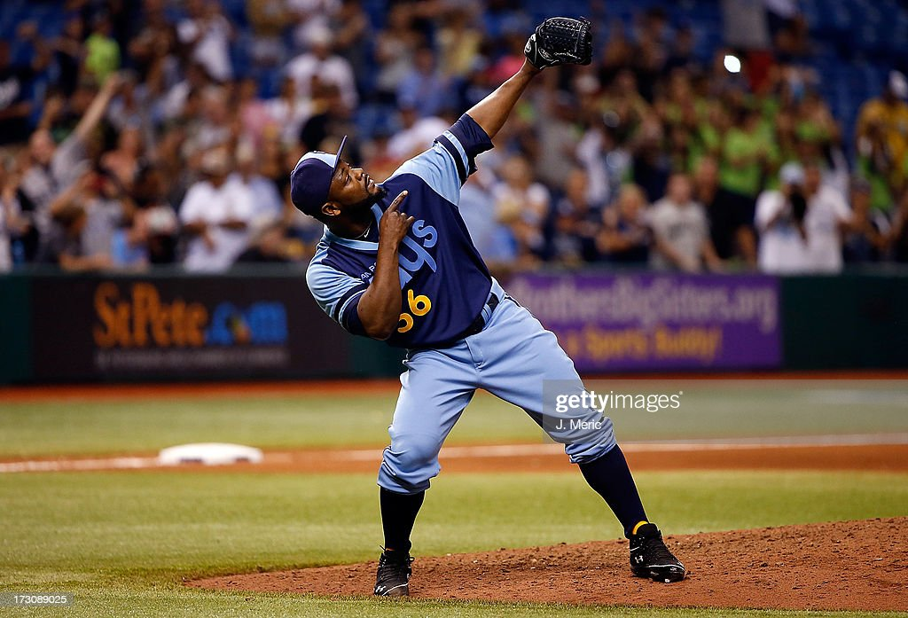 Pitcher <a gi-track='captionPersonalityLinkClicked' href=/galleries/search?phrase=Fernando+Rodney&family=editorial&specificpeople=547291 ng-click='$event.stopPropagation()'>Fernando Rodney</a> #56 of the Tampa Bay Rays celebrates his save over the Chicago White Sox at Tropicana Field on July 6, 2013 in St. Petersburg, Florida.