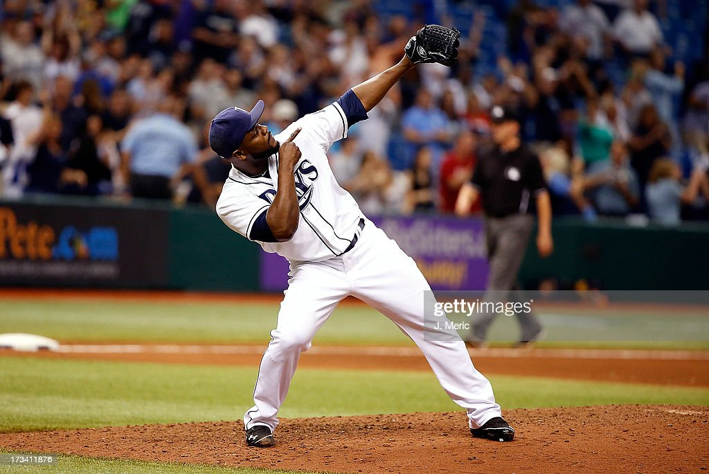 Pitcher <a gi-track='captionPersonalityLinkClicked' href=/galleries/search?phrase=Fernando+Rodney&family=editorial&specificpeople=547291 ng-click='$event.stopPropagation()'>Fernando Rodney</a> #56 of the Tampa Bay Rays celebrates his save over the Houston Astros at Tropicana Field on July 13, 2013 in St. Petersburg, Florida.