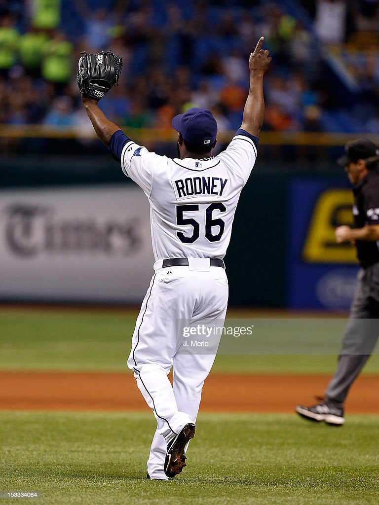 Pitcher <a gi-track='captionPersonalityLinkClicked' href=/galleries/search?phrase=Fernando+Rodney&family=editorial&specificpeople=547291 ng-click='$event.stopPropagation()'>Fernando Rodney</a> #56 of the Tampa Bay Rays celebrates save #48 after the game against the Baltimore Orioles at Tropicana Field on October 3, 2012 in St. Petersburg, Florida.