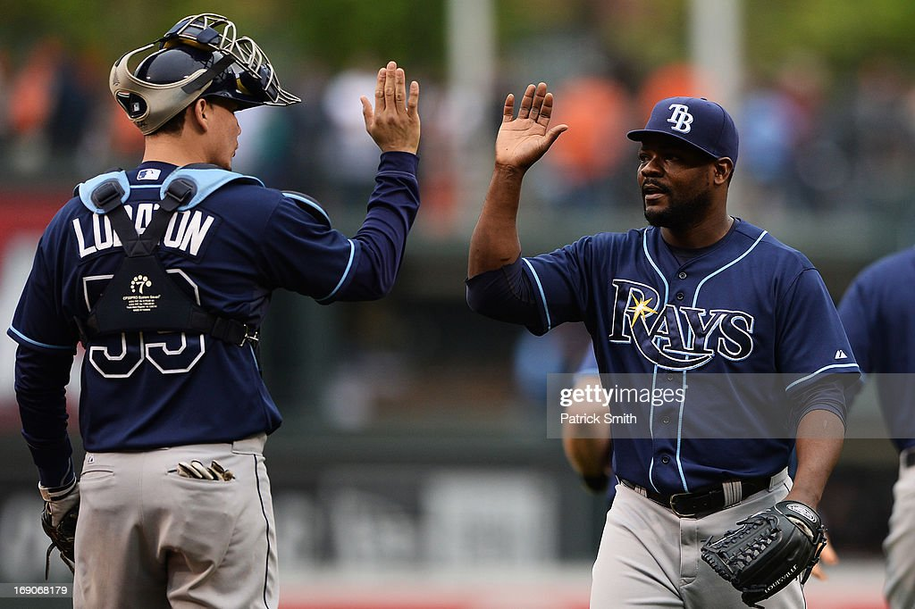 Pitcher <a gi-track='captionPersonalityLinkClicked' href=/galleries/search?phrase=Fernando+Rodney&family=editorial&specificpeople=547291 ng-click='$event.stopPropagation()'>Fernando Rodney</a> #56 of the Tampa Bay Rays celebrates with teammate Jose Lobaton #59 after defeating the Baltimore Orioles at Oriole Park at Camden Yards on May 19, 2013 in Baltimore, Maryland. The Tampa Bay Rays won, 3-1.