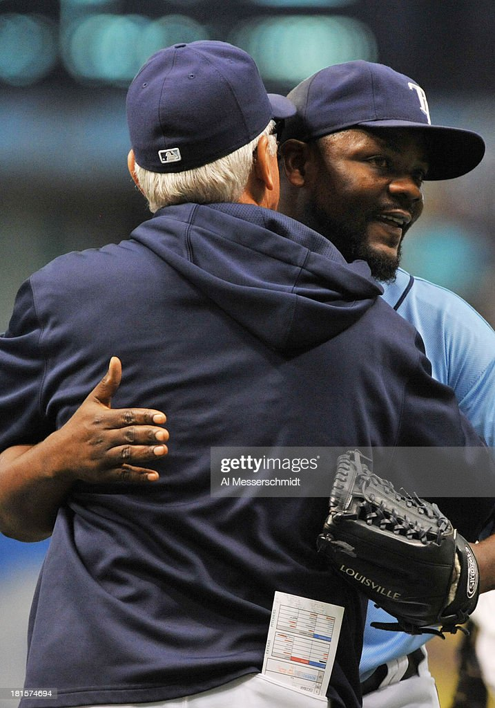 Pitcher Fernando Rodney #56 of the Tampa Bay Rays hugs manager Joe Maddon after the final out against the Baltimore Orioles September 22, 2013 at Tropicana Field in St. Petersburg, Florida. The Rays won 3 - 1.
