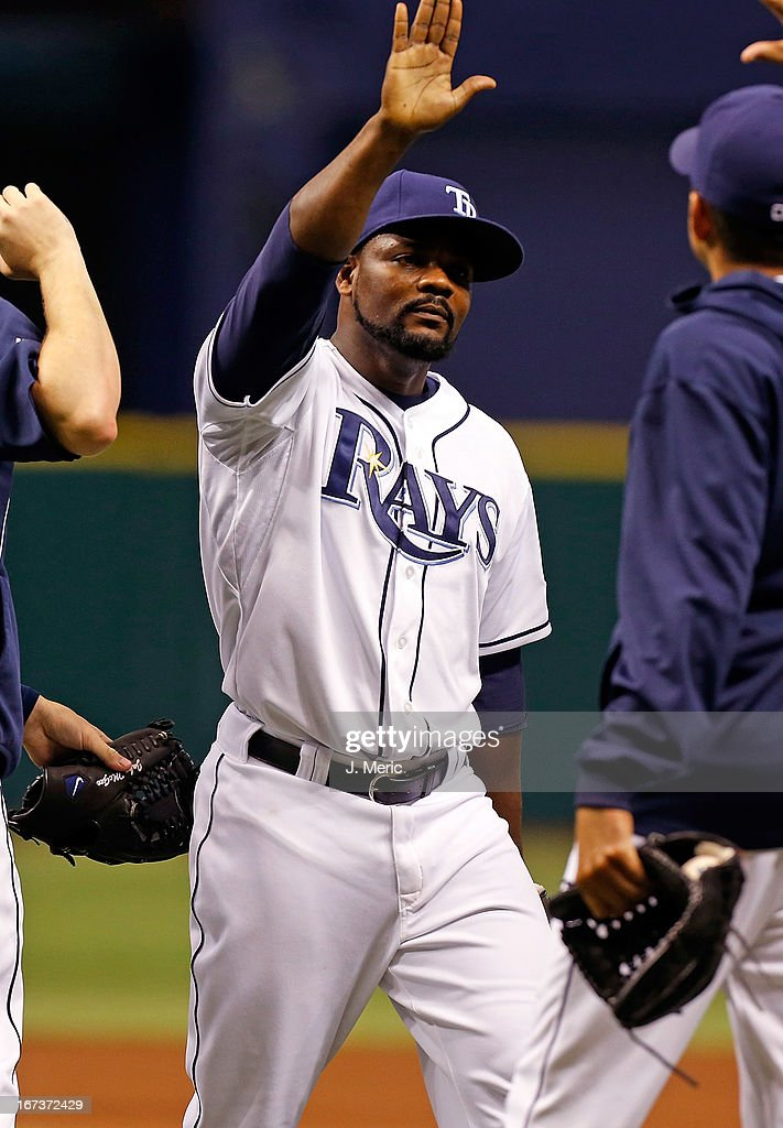 Pitcher <a gi-track='captionPersonalityLinkClicked' href=/galleries/search?phrase=Fernando+Rodney&family=editorial&specificpeople=547291 ng-click='$event.stopPropagation()'>Fernando Rodney</a> #56 of the Tampa Bay Rays is congratulated after the Rays victory over the New York Yankees at Tropicana Field on April 24, 2013 in St. Petersburg, Florida.