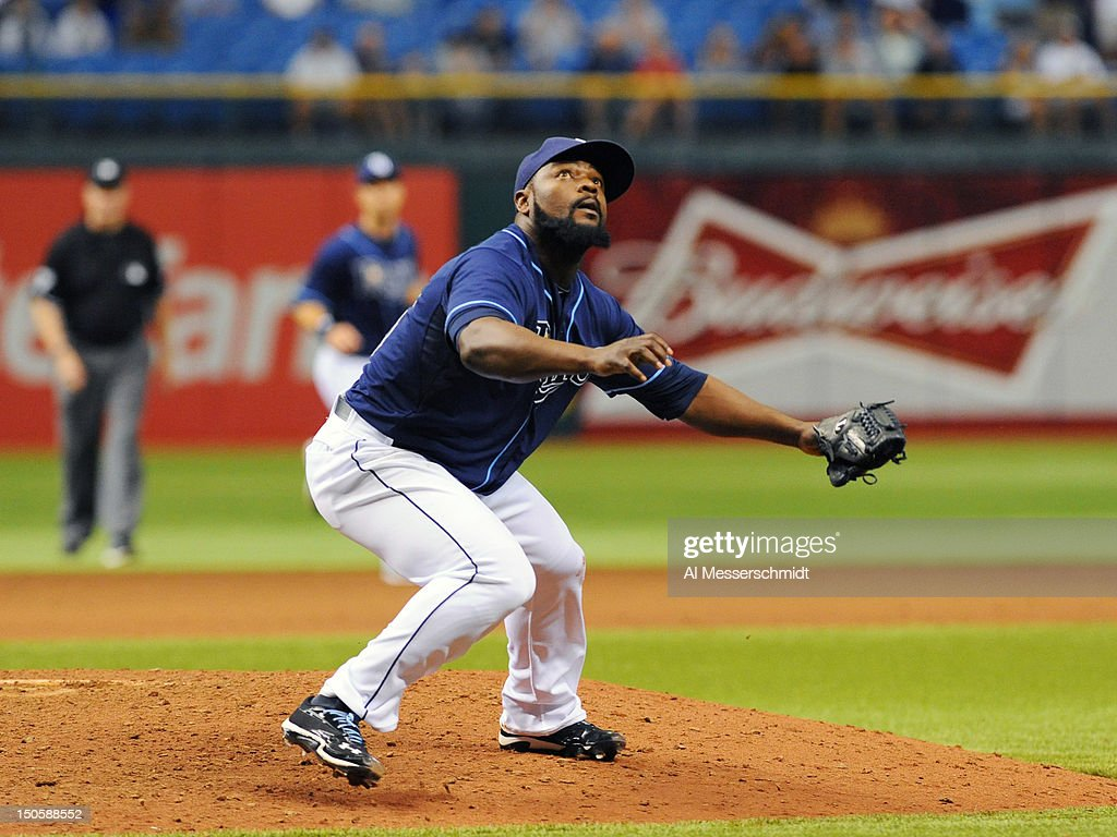 Pitcher <a gi-track='captionPersonalityLinkClicked' href=/galleries/search?phrase=Fernando+Rodney&family=editorial&specificpeople=547291 ng-click='$event.stopPropagation()'>Fernando Rodney</a> #56 of the Tampa Bay Rays looks for a popped up hit against the Kansas City Royals August 22, 2012 at Tropicana Field in St. Petersburg, Florida. Rodney pitched in relief and saved the game. The Rays won 5 - 3.