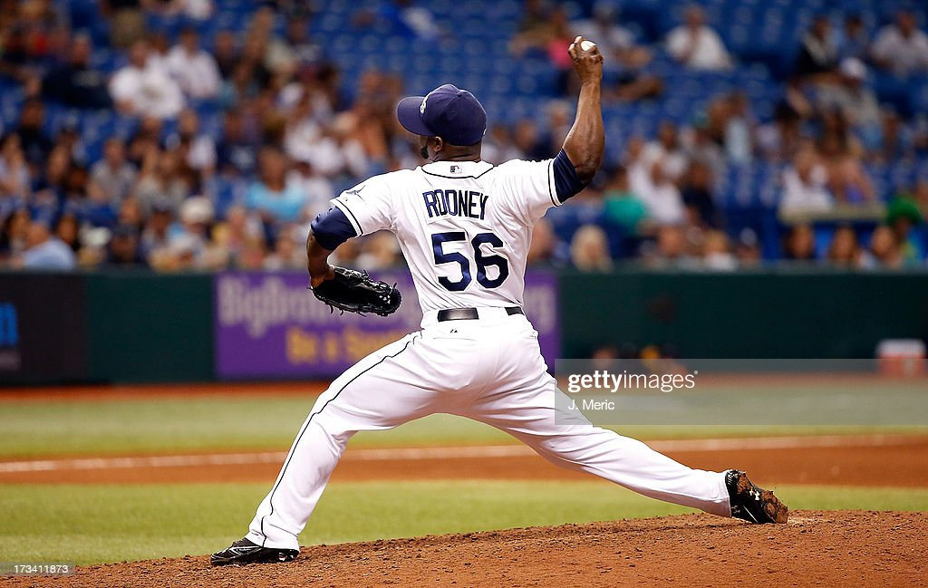 Pitcher <a gi-track='captionPersonalityLinkClicked' href=/galleries/search?phrase=Fernando+Rodney&family=editorial&specificpeople=547291 ng-click='$event.stopPropagation()'>Fernando Rodney</a> #56 of the Tampa Bay Rays pitches the ninth inning for his save over the Houston Astros at Tropicana Field on July 13, 2013 in St. Petersburg, Florida.