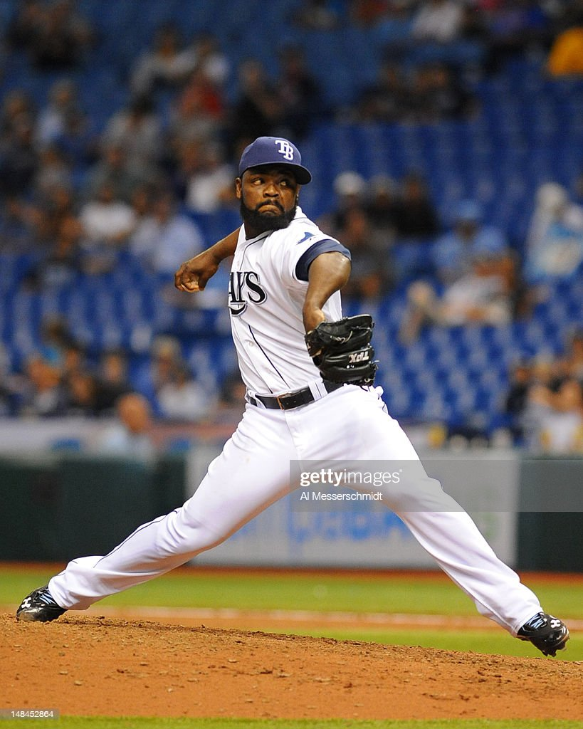 Pitcher <a gi-track='captionPersonalityLinkClicked' href=/galleries/search?phrase=Fernando+Rodney&family=editorial&specificpeople=547291 ng-click='$event.stopPropagation()'>Fernando Rodney</a> #56 of the Tampa Bay Rays throws in relief against the Cleveland Indians July 16, 2012 at Tropicana Field in St. Petersburg, Florida.