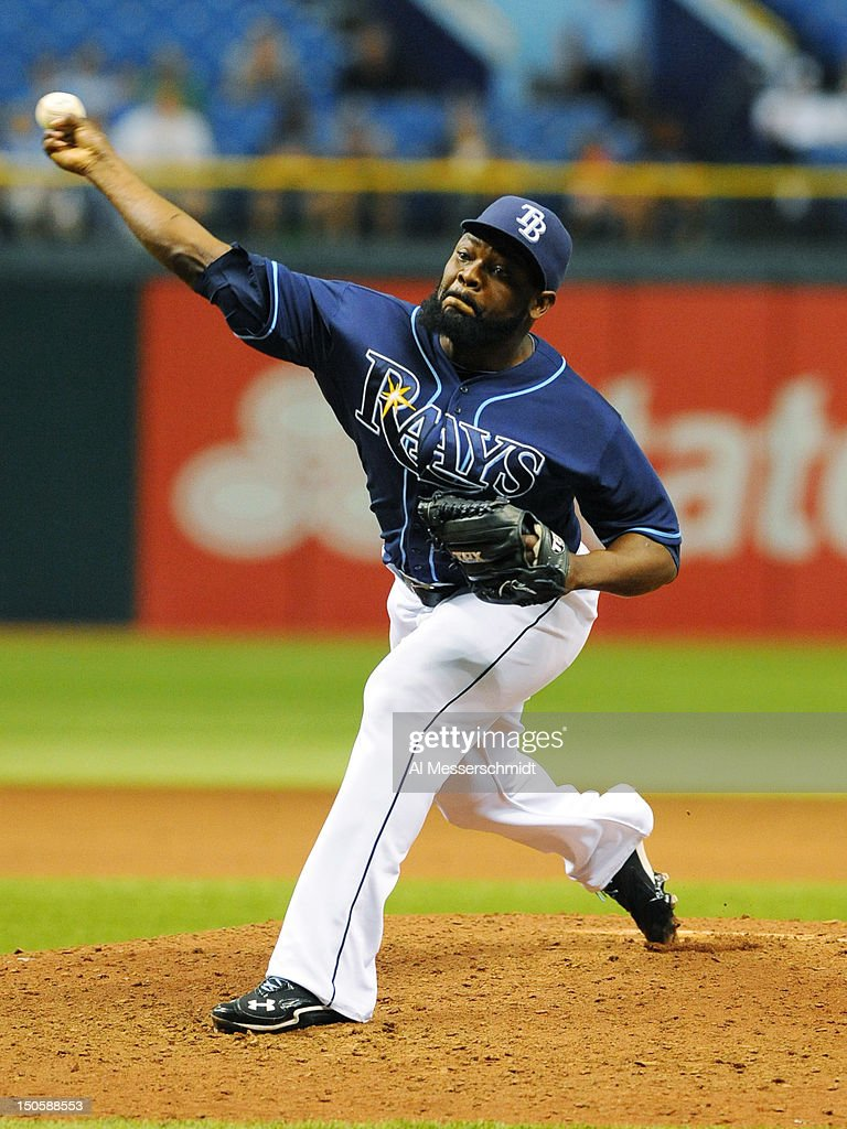 Pitcher <a gi-track='captionPersonalityLinkClicked' href=/galleries/search?phrase=Fernando+Rodney&family=editorial&specificpeople=547291 ng-click='$event.stopPropagation()'>Fernando Rodney</a> #56 of the Tampa Bay Rays throws in relief against the Kansas City Royals August 22, 2012 at Tropicana Field in St. Petersburg, Florida. Rodney saved the game. The Rays won 5 - 3.