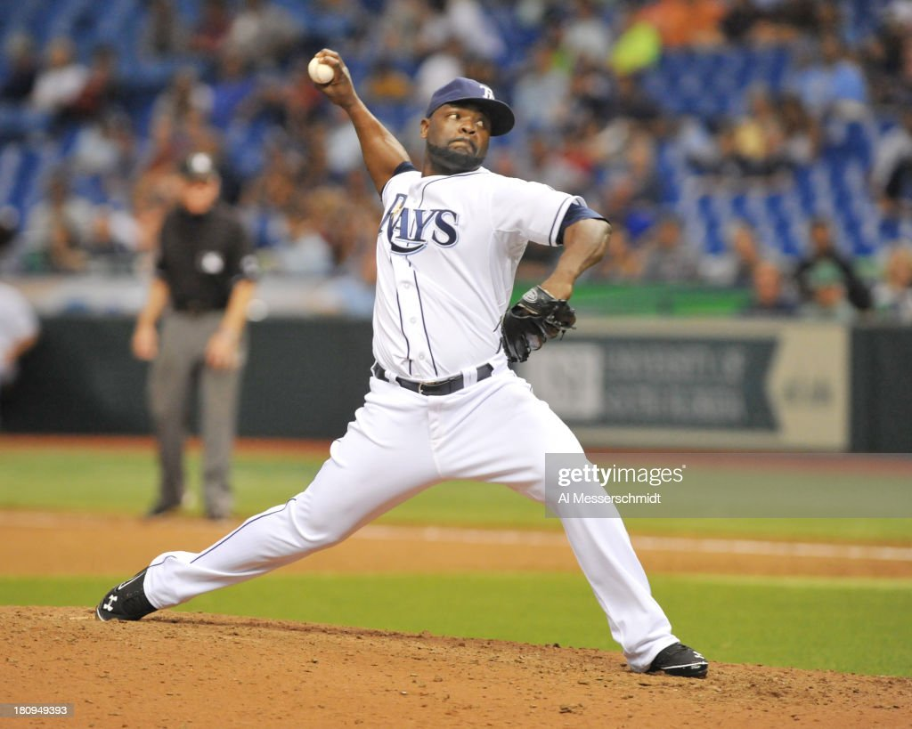 Pitcher <a gi-track='captionPersonalityLinkClicked' href=/galleries/search?phrase=Fernando+Rodney&family=editorial&specificpeople=547291 ng-click='$event.stopPropagation()'>Fernando Rodney</a> #56 of the Tampa Bay Rays throws in relief against the Boston Red Sox September 11, 2013 at Tropicana Field in St. Petersburg, Florida.