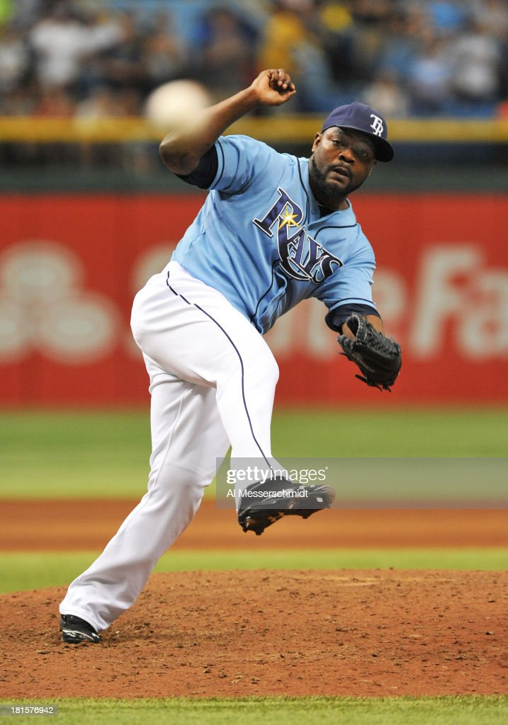 Pitcher <a gi-track='captionPersonalityLinkClicked' href=/galleries/search?phrase=Fernando+Rodney&family=editorial&specificpeople=547291 ng-click='$event.stopPropagation()'>Fernando Rodney</a> #56 of the Tampa Bay Rays throws in relief against the Baltimore Orioles September 22, 2013 at Tropicana Field in St. Petersburg, Florida. The Rays won 3 - 1.