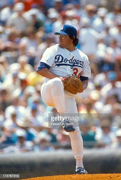 Pitcher Fernando Valenzuela of the Los Angeles Dodgers pitches during an Major League Baseball spring training game circa 1990 in Vero Beach Florida...