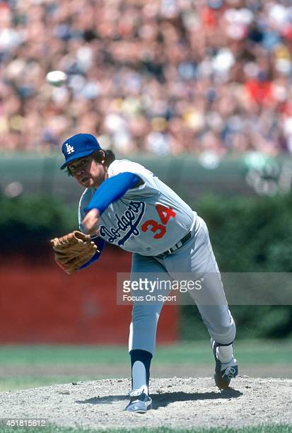 Pitcher Fernando Valenzuela of the Los Angeles Dodgers pitches against the Chicago Cubs during an Major League Baseball game circa 1981 at Wrigley...