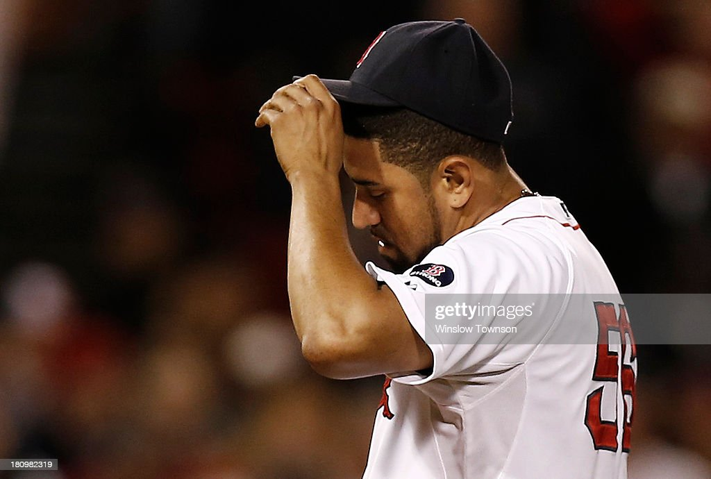 Pitcher <a gi-track='captionPersonalityLinkClicked' href=/galleries/search?phrase=Franklin+Morales&family=editorial&specificpeople=4175198 ng-click='$event.stopPropagation()'>Franklin Morales</a> #56 of the Boston Red Sox hangs his head after giving up the winning two-run single to Chris Davis #19 of the Baltimore Orioles during the twelfth inning of their 5-3 loss at Fenway Park on September 18, 2013 in Boston, Massachusetts.