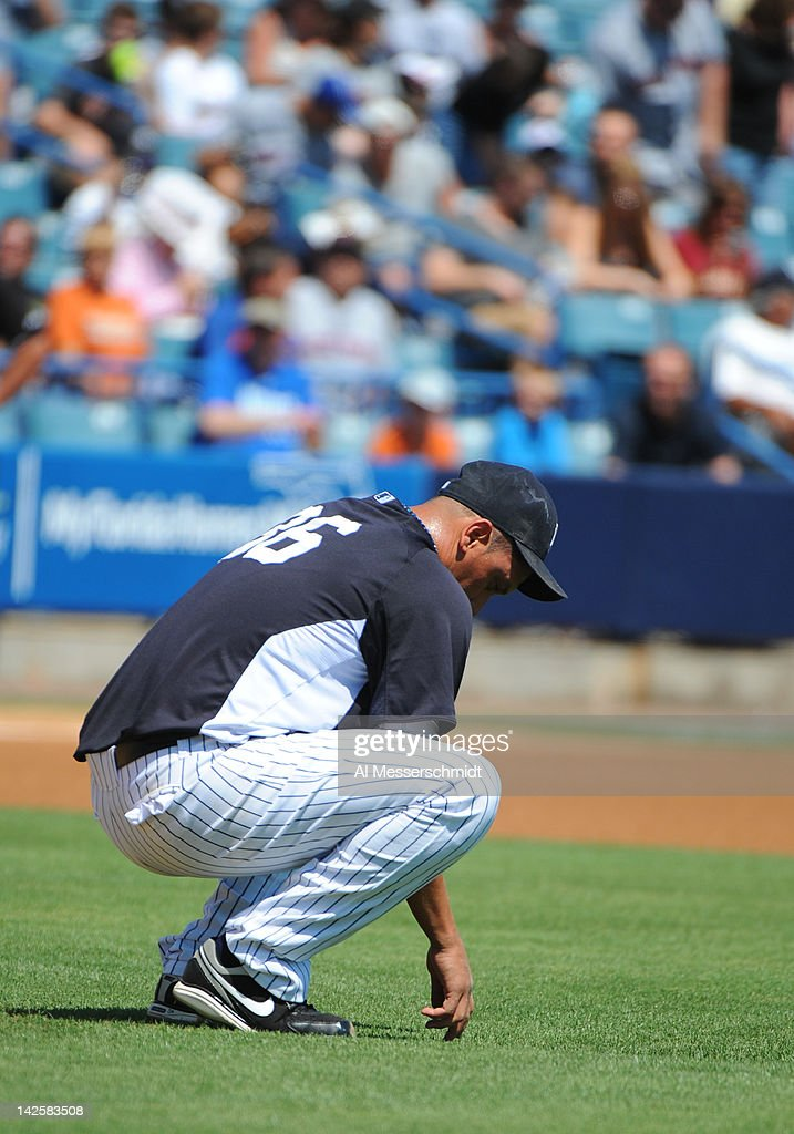 Pitcher Freddy Garcia #36 of the New York Yankees pauses behind the mound before the first pitch against the New York Mets in a spring training game April 4, 2012 at George M. Steinbrenner Field in Tampa, Florida.