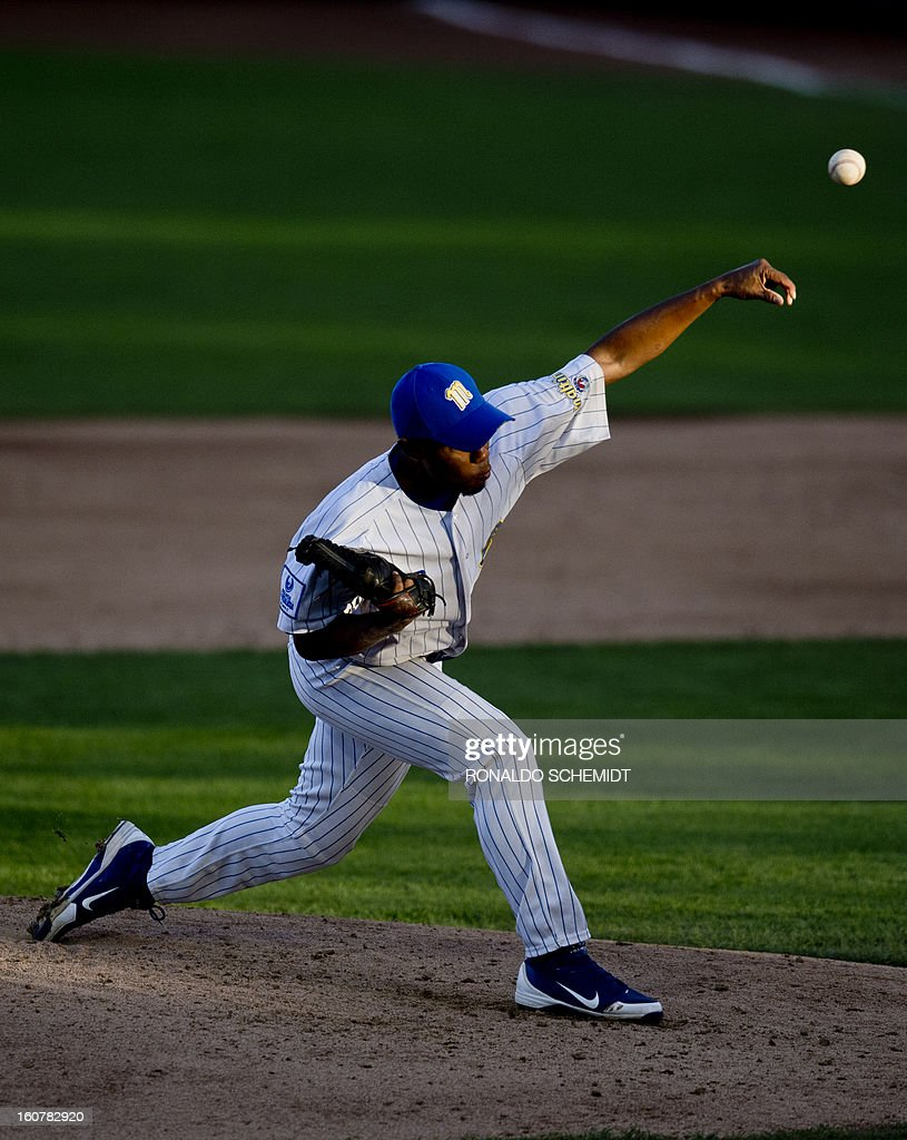 Pitcher Gabriel Garcia of Magallanes of Venezuela pitches against Criollos de Caguas of Puerto Rico, during the 2013 Caribbean baseball series, on February 5, 2013, in Hermosillo, Sonora State, in the northern of Mexico. AFP PHOTO/Ronaldo Schemidt