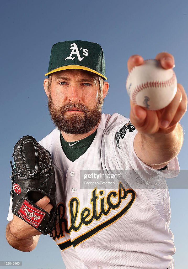 Pitcher Garrett Olson #53 of the Oakland Athletics poses for a portrait during the spring training photo day at Phoenix Municipal Stadium on February 18, 2013 in Phoenix, Arizona.