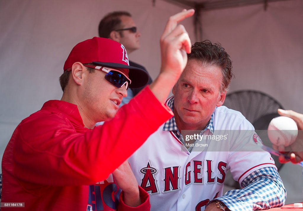 Pitcher <a gi-track='captionPersonalityLinkClicked' href=/galleries/search?phrase=Garrett+Richards&family=editorial&specificpeople=5772916 ng-click='$event.stopPropagation()'>Garrett Richards</a> #43 of the Los Angeles Angels of Anaheim and former Angels pitcher <a gi-track='captionPersonalityLinkClicked' href=/galleries/search?phrase=Chuck+Finley&family=editorial&specificpeople=242777 ng-click='$event.stopPropagation()'>Chuck Finley</a> talk while Richards signs autographs before the game against the Tampa Bay Rays at Angel Stadium of Anaheim on May 7, 2016 in Anaheim, California.
