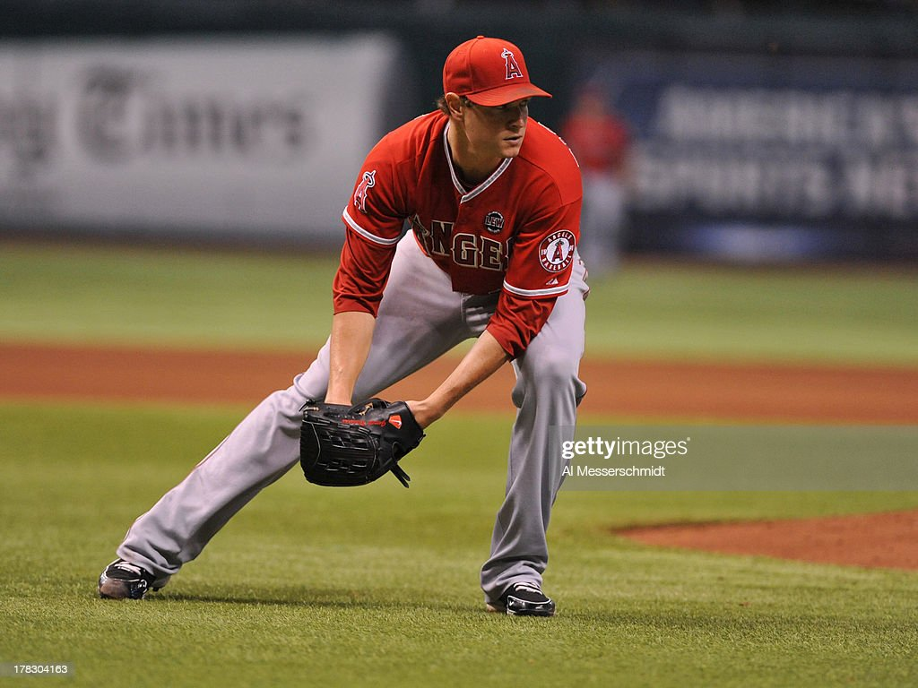 Pitcher <a gi-track='captionPersonalityLinkClicked' href=/galleries/search?phrase=Garrett+Richards&family=editorial&specificpeople=5772916 ng-click='$event.stopPropagation()'>Garrett Richards</a> #43 of the Los Angeles Angels of Anaheim of Anaheim fields a bunt against the Tampa Bay Rays August 28, 2013 at Tropicana Field in St. Petersburg, Florida. The Rays won 4 - 1.