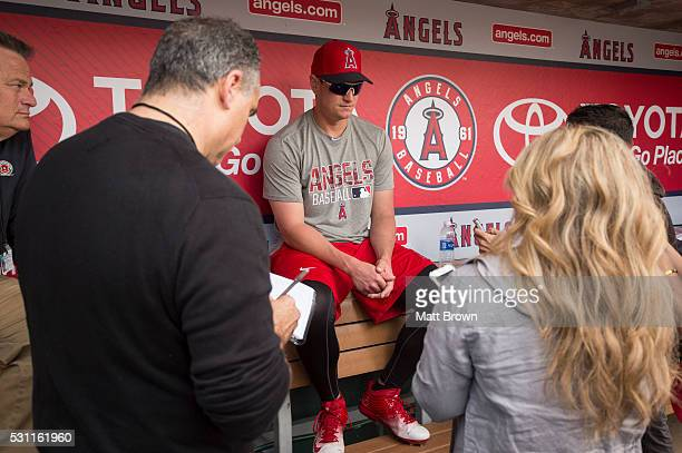 Pitcher Garrett Richards of the Los Angeles Angels of Anaheim speaks to the media in the dugout about his elbow injury before the game against the...