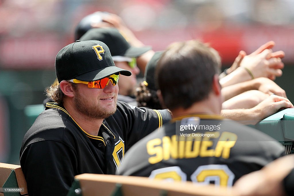 Pitcher <a gi-track='captionPersonalityLinkClicked' href=/galleries/search?phrase=Gerrit+Cole&family=editorial&specificpeople=7072350 ng-click='$event.stopPropagation()'>Gerrit Cole</a> #45 of the Pittsburgh Pirates looks on from the dugout during the MLB game against the Los Angeles Angels of Anaheim at Angel Stadium of Anaheim on June 23, 2013 in Anaheim, California. The Pirates defeated the Angels 10-9 in ten innings.