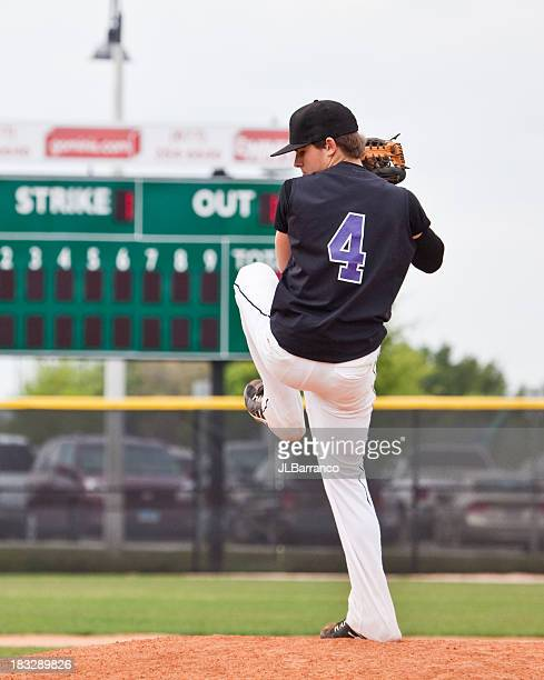 A pitcher getting ready to throw the ball on the field