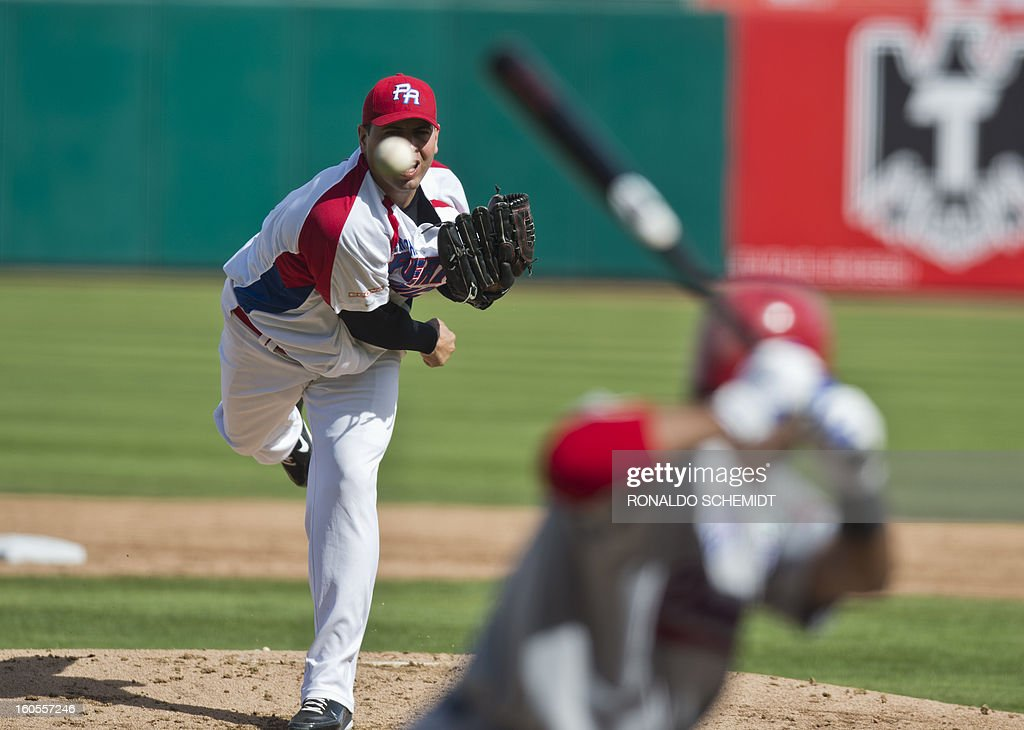 Pitcher Giancarlo Alvarado of Criollos de Caguas of Puerto Rico pitches against Leones del Escogido of Dominican Republic, during the 2013 Baseball Caribbean Series, on February 2, 2013, in Hermosillo, Sonora State, northern Mexico. AFP PHOTO/Ronaldo Schemidt