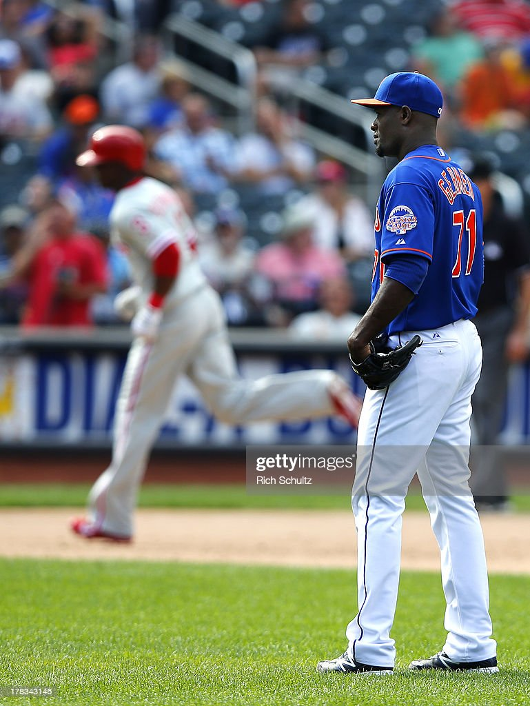 Pitcher Gonzalez Germen #71of the New York Mets looks to home plate as <a gi-track='captionPersonalityLinkClicked' href=/galleries/search?phrase=Roger+Bernadina&family=editorial&specificpeople=4246414 ng-click='$event.stopPropagation()'>Roger Bernadina</a> #3 of the Philadelphia Phillies rounds the bases after hitting a two run home run in the eighth inning on August 29, 2013 at Citi Field in the Flushing neighborhood of the Queens borough of New York City.