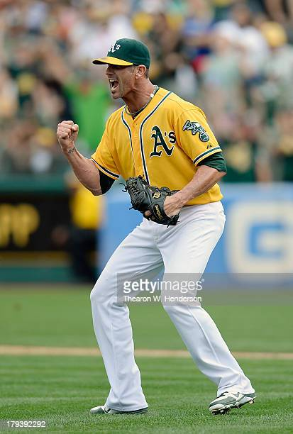 Pitcher Grant Balfour of the Oakland Athletics celebrates after he gets Adrian Beltre of the Texas Rangers to ground out to third base for the final...