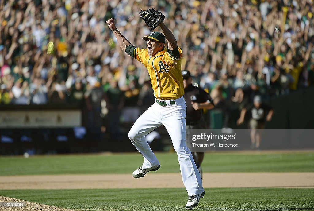 Pitcher Grant Balfour #50 of the Oakland Athletics celebrates defeating the Texas Rangers 12 to 5 and capturing the American League West title at O.co Coliseum on October 3, 2012 in Oakland, California.