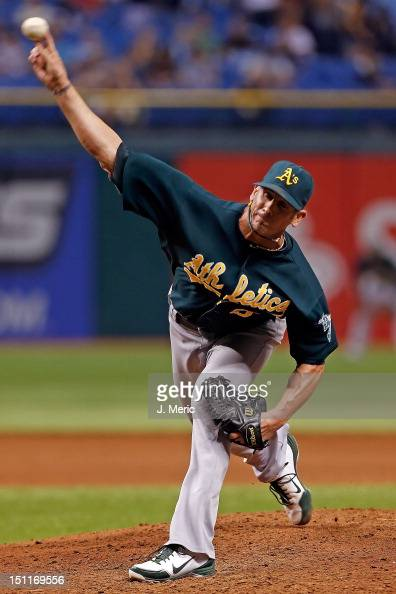 Pitcher Grant Balfour of the Oakland Athletics pitches against the Tampa Bay Rays during the game at Tropicana Field on August 24 2012 in St...