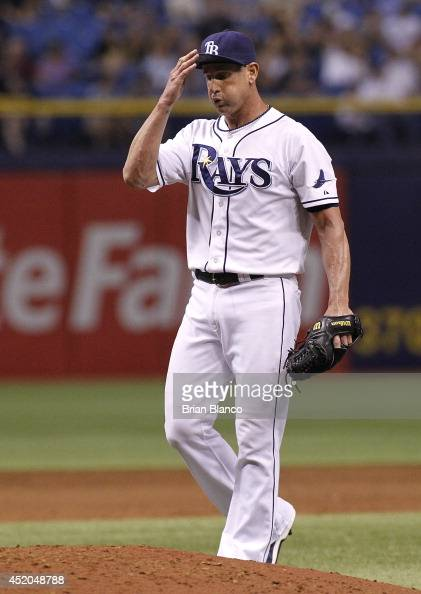 Pitcher Grant Balfour of the Tampa Bay Rays reacts on the mound after allowing a tworun single by Steve Tolleson of the Toronto Blue Jays during the...