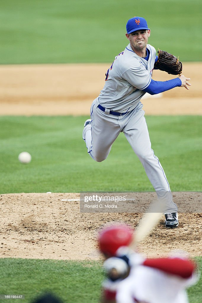 Pitcher Greg Burke #46 of the New York Mets pitches during a spring training game against the St. Louis Cardinals on March 24, 2013 at Roger Dean Stadium in Jupiter, Florida.