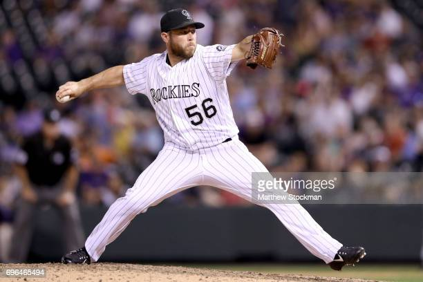 Pitcher Greg Holland of the Coloarado Rockies throws in the ninth inning against the San Francisco Giants at Coors Field on June 15 2017 in Denver...