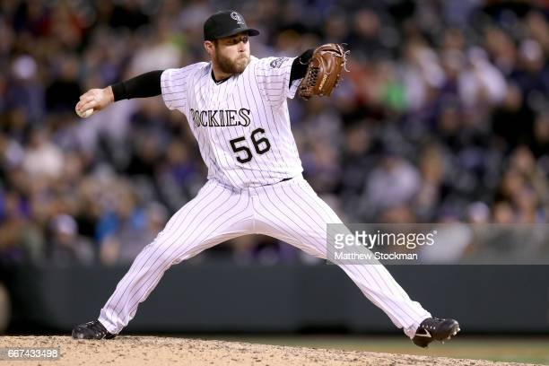 Pitcher Greg Holland of the Colorado Rockies throws against the San Diego Padres at Coors Field on April 11 2017 in Denver Colorado