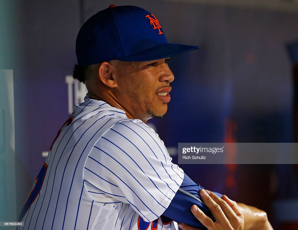 Pitcher Hansel Robles of the New York Mets holds his elbow after being removed in the seventh inning of a game against the Arizona Diamondbacks at...