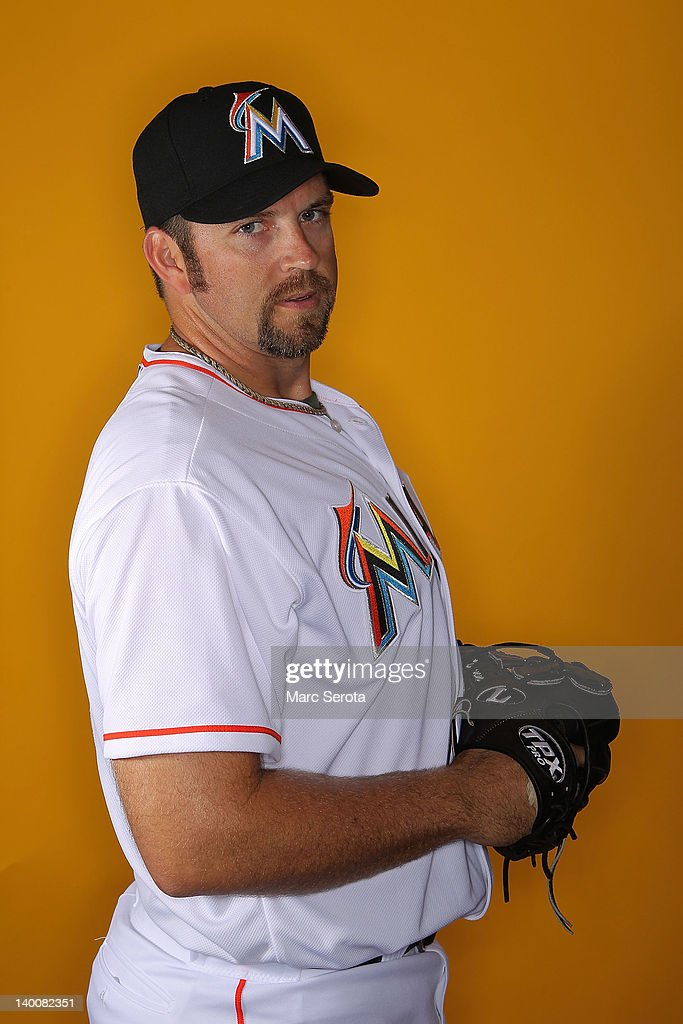 Pitcher <a gi-track='captionPersonalityLinkClicked' href=/galleries/search?phrase=Heath+Bell&family=editorial&specificpeople=243211 ng-click='$event.stopPropagation()'>Heath Bell</a> #21 of the Miami Marlins poses for photos during media day at Roger Dean Stadium on February 27, 2012 in Jupiter, Florida.