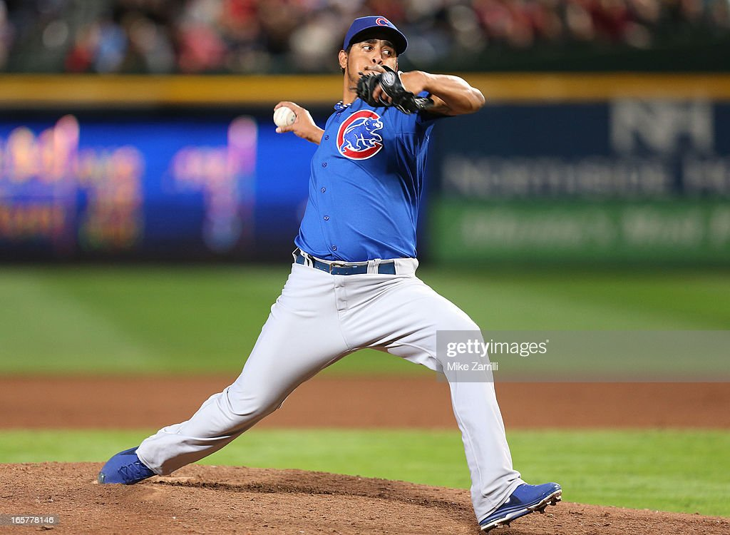 Pitcher Hector Rondon #56 of the Chicago Cubs throws a pitch during the game against the Atlanta Braves at Turner Field on April 5, 2013 in Atlanta, Georgia.