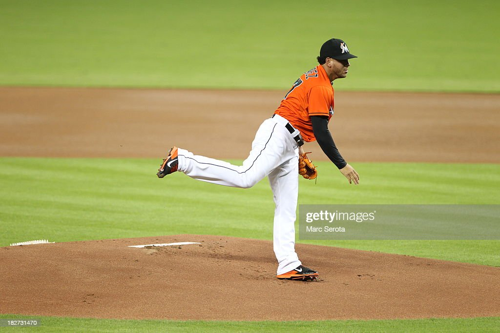 Pitcher <a gi-track='captionPersonalityLinkClicked' href=/galleries/search?phrase=Henderson+Alvarez&family=editorial&specificpeople=7091625 ng-click='$event.stopPropagation()'>Henderson Alvarez</a> #37 of the Miami Marlins throws against the Philadelphia Phillies at Marlins Park on September 24, 2013 in Miami, Florida. The Phillies defeated the Marlins 2-1 to give Miami 100 losses for the season.