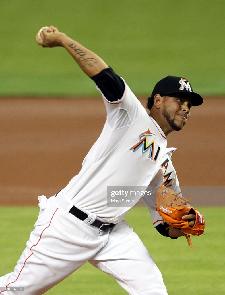 Pitcher <a gi-track='captionPersonalityLinkClicked' href=/galleries/search?phrase=Henderson+Alvarez&family=editorial&specificpeople=7091625 ng-click='$event.stopPropagation()'>Henderson Alvarez</a> #37 of the Miami Marlins throws against the San Francisco Giants during the first inning at Marlins Park on August 17, 2013 in Miami, Florida.