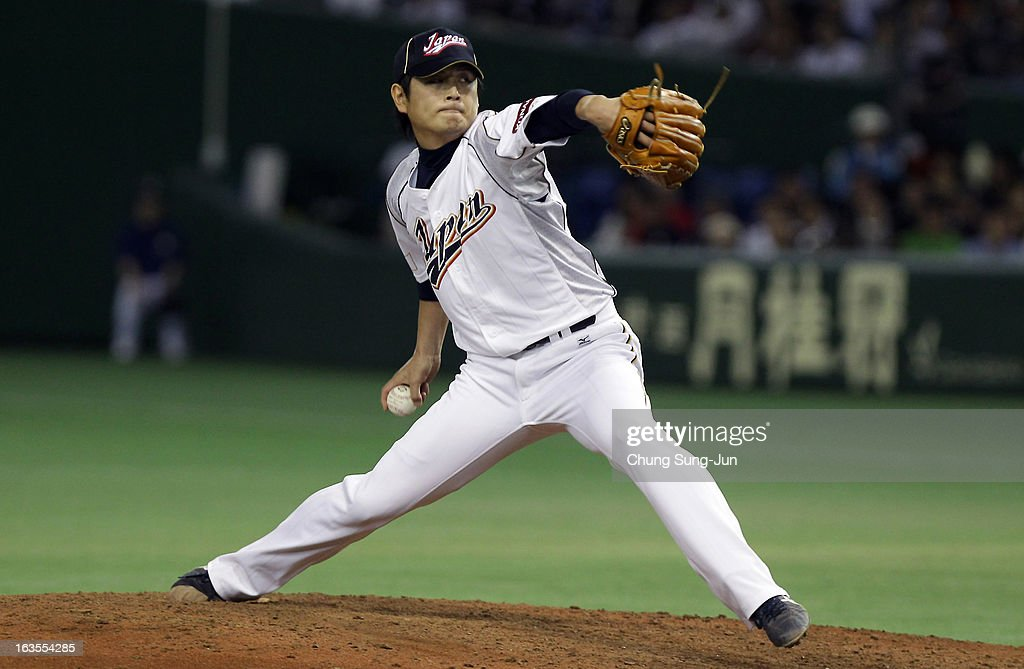 Pitcher <a gi-track='captionPersonalityLinkClicked' href=/galleries/search?phrase=Hideaki+Wakui&family=editorial&specificpeople=5491133 ng-click='$event.stopPropagation()'>Hideaki Wakui</a> #11 of Japan pitches in the eighth inning during the World Baseball Classic Second Round Pool 1 game between Japan and the Netherlands at Tokyo Dome on March 12, 2013 in Tokyo, Japan.