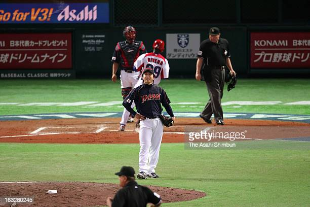 Pitcher Hirokazu Sawamura of Japan reacts after being hit a RBI single by infielder Jose Abreu of Cuba in the bottom of six inning during the World...