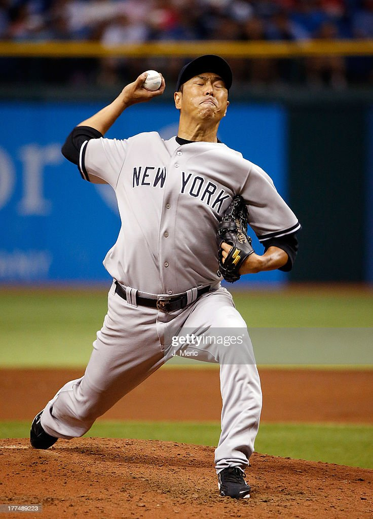 Pitcher <a gi-track='captionPersonalityLinkClicked' href=/galleries/search?phrase=Hiroki+Kuroda&family=editorial&specificpeople=5498664 ng-click='$event.stopPropagation()'>Hiroki Kuroda</a> #18 of the New York Yankees pitches against the Tampa Bay Rays during the game at Tropicana Field on August 23, 2013 in St. Petersburg, Florida.