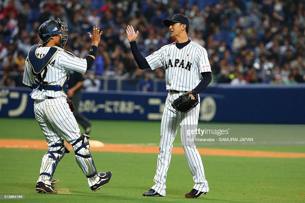Pitcher Hirotoshi Masui #19 of Japan celerates after winning during the international friendly match between Japan and Chinese Taipei at the Nagoya Dome on March 5, 2016 in Nagoya, Aichi, Japan.